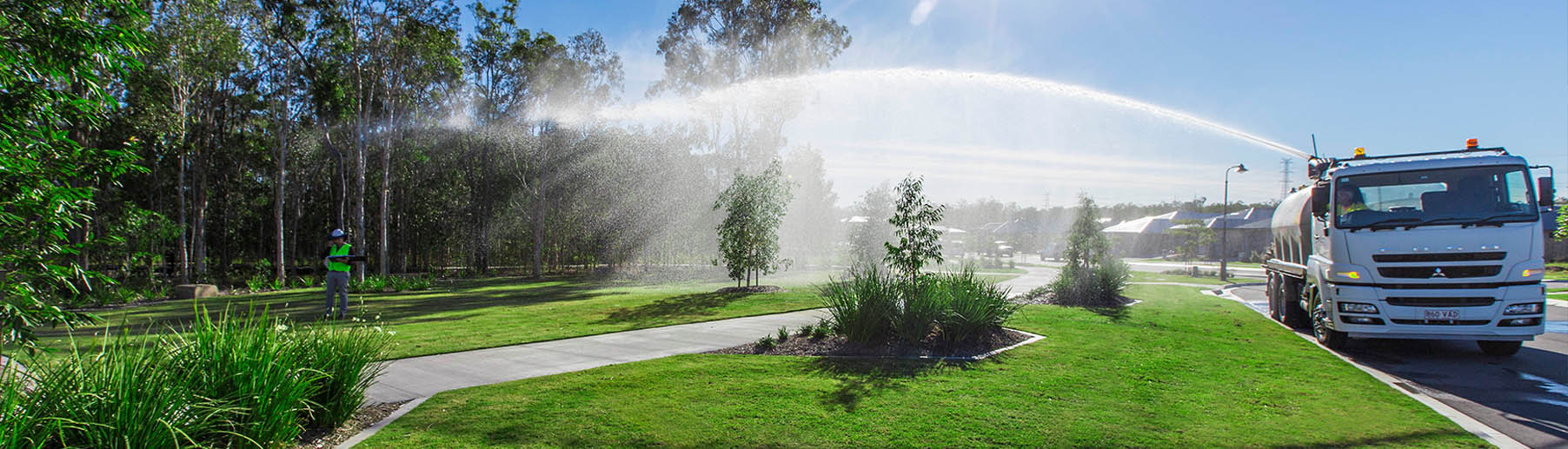 truck watering grass